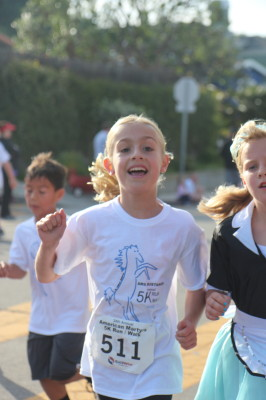 AMS first-grader Emily Pfaff doesn't even break a sweat as she nears the finish line.