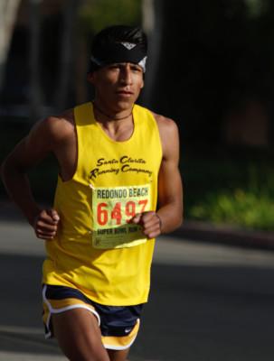 10k winner Alfredo Coronado, who crossed the finish line in 32:05. Photo by Ray Vidal