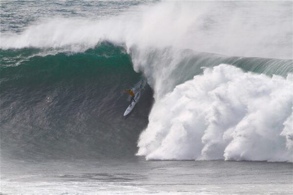 Shawn Dollar of Santa Cruz gets deep and steep on what would have won Best Wave honors if he hadn't fallen at the bottom and suffered one of the worst wipeouts of the day. Photo by Mike Balzer.