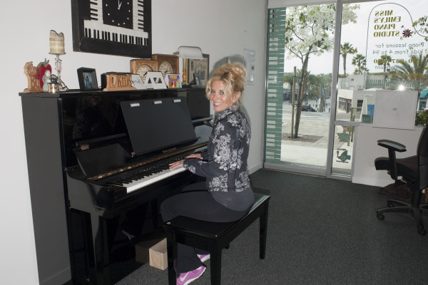 Emily Baum practices in her Pier Ave. studio. Photo by Chelsea Schreiber