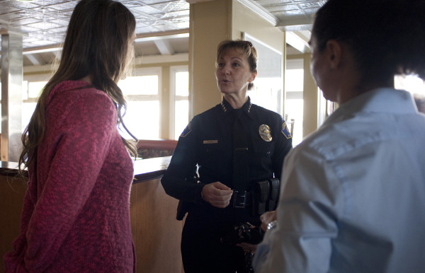 "HBPD Chief Sharon Papa talks to residents during a ""Pizza with Police"" event. Photo b Chelsea Schreiber"