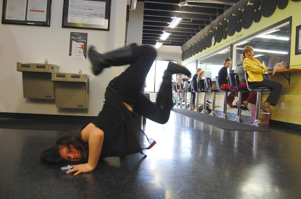 Avalon Stone, 10, shows off a break-dance move inside the Manhattan Beach School of Dance and Music. Photo by Esther Kang