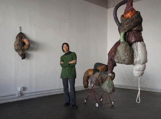 Connie DK Lane with her sculptures Gloria Plascencia, Contributing Photographer