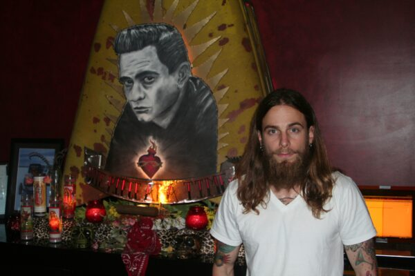 Gasser Lounge's Mike Bouchard at the Johnny Cash shrine. Photo by Kevin Cody.