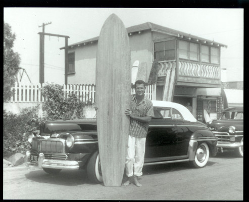 John McFarlane with his '46 Merc and his Velzy board in front of Velzy's home on Loma Drive. It was the 5th balsa board Velzy had ever shaped. Photo courtesy of Susan McFarlane