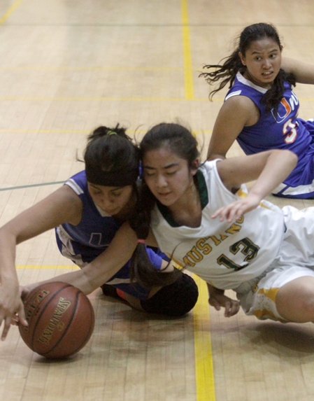 Keilani Ikehara scrambles for a loose ball during Mira Costa's opening-round win in the Southern California Regional playoffs. Photo by Ray Vidal