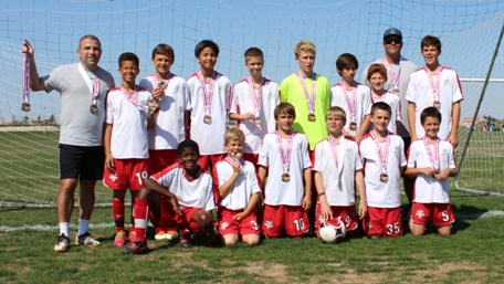 Region 34 Boys U13 EXTRA State runner-up included (back row) Coach Samer Raad, Kwess Vega, Aidan Goldfield, Teddy Su, Jack Vorndran, Ryan Hughes, Dylan Gamsby, Joey Raad, Asst. Coach Bob Vogelsang, Blake Vogelsang, (front row) Elvis Patton, Bo Lovold, Collin Paludi, Tucker Gadsby, Dom Schiappa and Dylan McDonough, Not pictured: Coach Leanne Raad. Photo by Natalie Goldfield