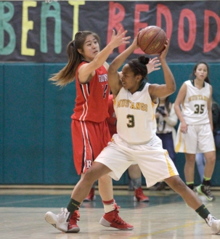 Mira Costa senior Camille Mills battles Redondo's Nao Shiota in the Mustang's Division 2AA semifinal win. Photo by Ray Vidal