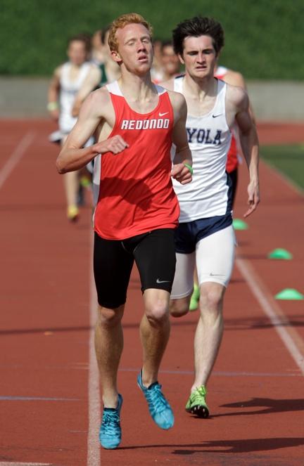 Redondo senior Dustin Herold holds off Loyola's John McAndrews to win the 1,600 meter race. Photo by Ray Vidal