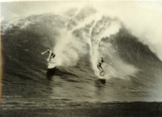 McFarlane with Buzzy Trent at Waimea on an early trip to the islands.