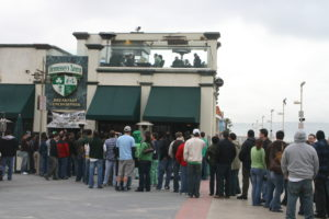 A typical lunchtime line for a seat on Hennessey's upstairs patio -- on St. Patrick's Day. Photo by Kevin Cody