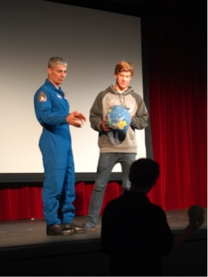 Col. Mark Vande Hei and PVHS sophomore Chandler Jones demonstrate the distance between the earth and the moon.