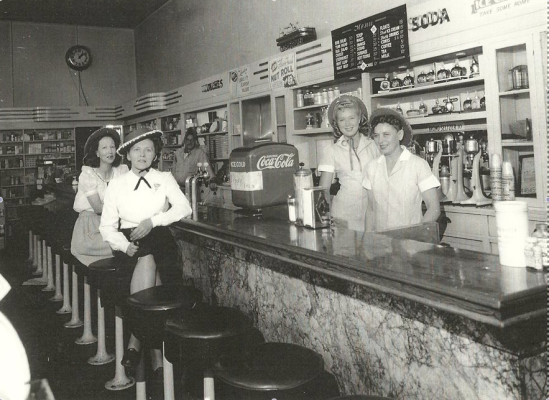 Arliene Otis (second from right) behind the soda counter at the Opal Pharmacy in Redondo where she met her future husband Chuck Hillinger.