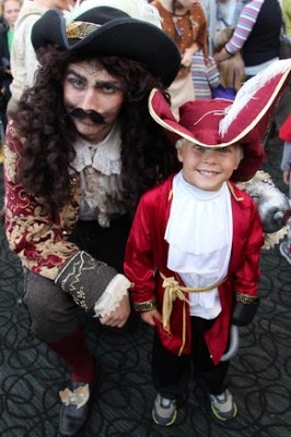 """Four-and-one-half year old Crosby Hedrick, who anchors his galleon in Manhattan Beach and goes by the moniker """"Little Hook,"""" consents to pose with Captain Hook (Paxton Wright) after watching """"Peter Pan"""" on stage. Another meet-and-greet takes place after the 2 p.m. matinee this Saturday. COURTESY OF KATHY SENA"""