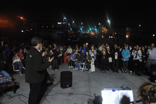 Joe Galliani, 350.org's South Bay director, addresses the crowd on Manhattan Beach pier. Photo by Kelley Kim