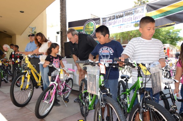 South Bay children receive new Trek mountain bikes during the annual PVG Foundation Bicycle giving outside Buffalo Fire Department restaurant in Torrance. Photo courtesy of PVG Group Foundation