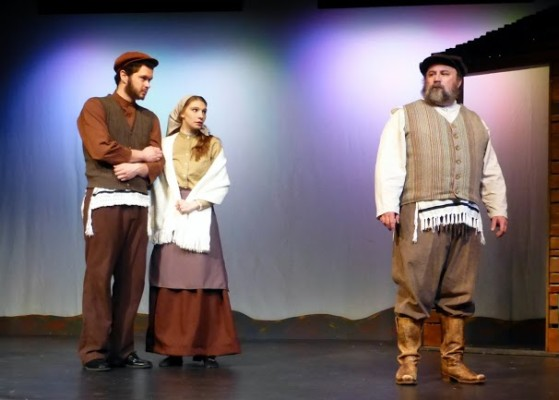 Tevye considers breaking tradition and allowing Motel to marry his daughter, Tzeitel. Left to right: Nathan Fleischer, Kelsey Nisbett, and Bradley Miller. PHOTO COURTESY SHARI BARRETT