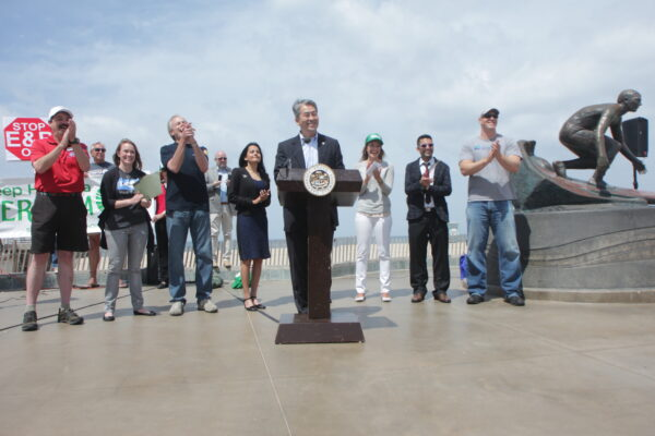 State Assemblyman Al Muratsuchi (D-66th District) announces AB 2711 at the Hermosa Beach pier in April. He was joined by (left to right) South Bay 350's Joe Galliani, Heal the Bay's Sarah Sikich, Surfrider's Craig Cadwallader, Hermosa Beach councilwoman Nanette Barragan, State Senator Ted Lieu, Stop Hermosa Beach Oil's Stacey Amato, Earthworks' Jhon Arbelaez,  and Los Angeles Waterkeeper's Brian Meux. Photo by Kevin Cody