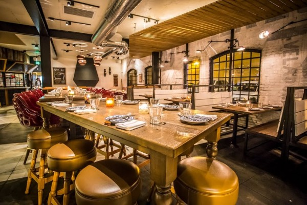 Dia de Campo' dining room combines rustic and industrial influences.