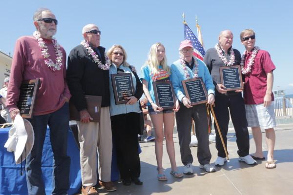 2014 Surfer's Walk of Fame Pioneer inductees (left to right) Beacher Anderson, Bob Bergstrom, Stu Lindner's wife, Finn Sanders (Mo Meine's great granddaughter), Fenton Scholes, Warren Miller and Hermosa Beach Mayor Michael DiVirgilio.