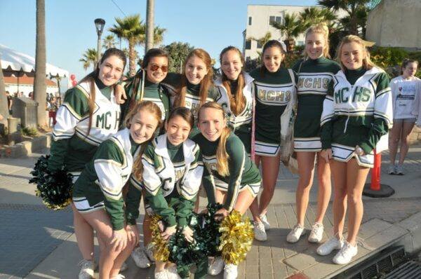 Mira Costa High cheerleaders will be cheering on walkers in the Richstone Pier to Pier Walkathon on Saturday, April 26. The walk starts at the Manhattan Beach pier at 7 a.m. and raises funds for the Richstone Family Center. For more information visit RichstoneFamily.org Photo by Michael McKinney