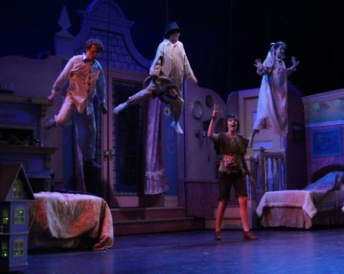 """It's hard to say if they're actually flying or getting ready for a space walk, but characters definitely take to the air in Mira Costa's production of """"Peter Pan."""" COURTESY OF KATHY SENA"""