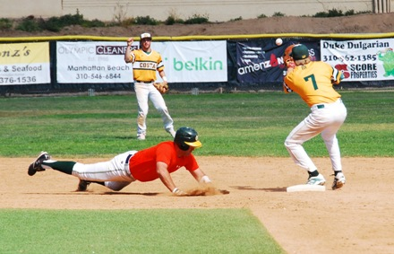 Alumni first baseman Ryan Brincat dives back into second base ahead of shortstop Mateo Nieto's throw to Robert White. Brincat was drafted by the Seattle Mariners in 2001. Photo by Randy Angel