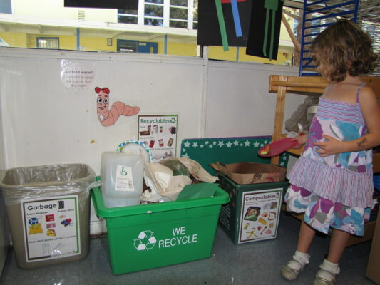 Carly Jacecko, a student at South Bay Family Tree Preschool, sorts her waste in the classroom. Courtesy of Kathleen Jacecko