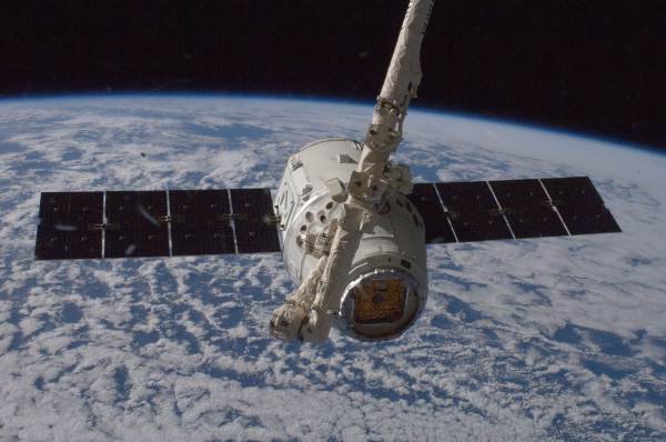 The Dragon spacecraft, a reusable robotic space craft created by SpaceX, journeys through space to dock with the International Space Station 2012. Photo property of SpaceX.