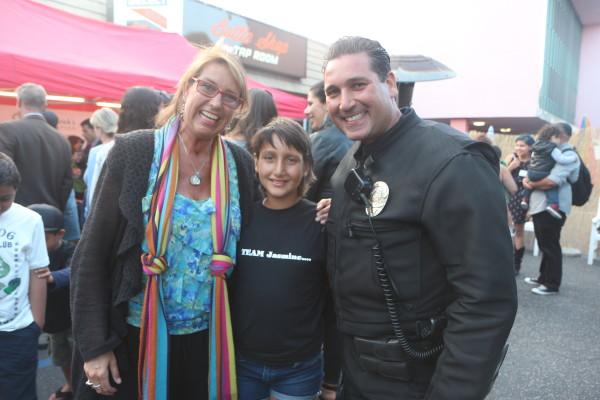 Cancer survivors Adrienne Slaughter and Jasmine Faulk with Jasmine's father Everett, a Hermosa Beach police officer.