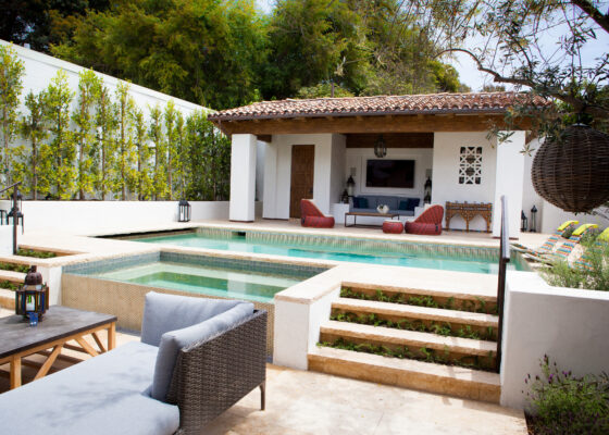The backyard cabana gives an Old World feel to this newly built Spanish Colonial design.
