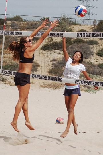 Mira Costa's Emma Smith, right, hits the ball past Skylar Caputo in the championship match.