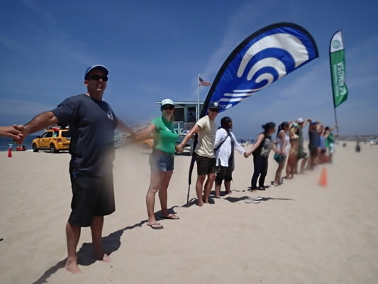 Hands Across The Sands activists in Hermosa Beach Saturday morning .
