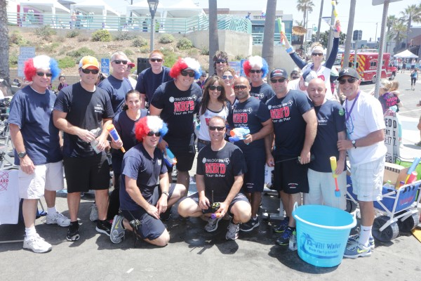 Manhattan Beach Police Chief Eve Irvine (standing, third from left) and members of the      Manhattan Beach police and fire departments.