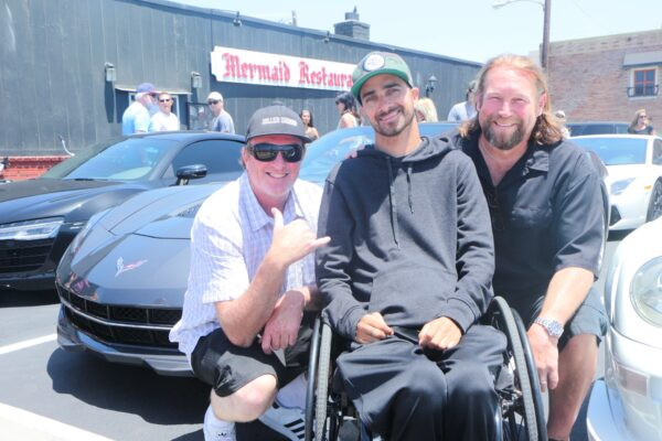 Life Rolls On founder Jesse Billauer (center) with Killer Shrimp partners Kevin Michaels and Brad Doherty at the partner's Mermaid restaurant in Hermosa Beach, where Sunday's exotic car rally ended. Photos by Kevin Cody
