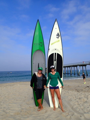 Hermosa Beach's Tamara Lentz and Antoinette Coco at Monday's races. Lentz won both the Hennessey's Return to the Pier and USSUP Michelob Ultra pro division. Coco finished second in the Return to the Pier. Photo by Kevin Cody