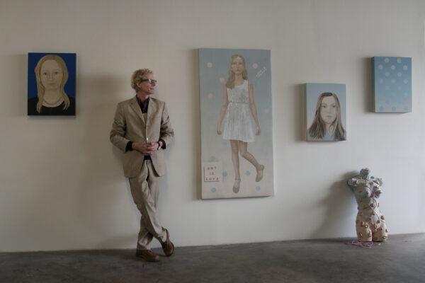 Paulin Paris with portraits of his daughter. GLORIA PLASCENCIA, CONTRIBUTING PHOTOGRAPHER