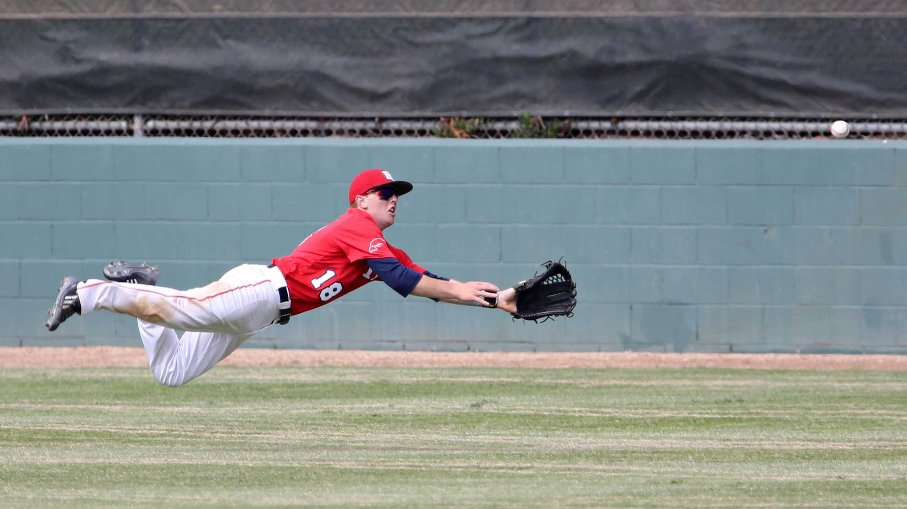 Redondo Union center fielder Jason Clebowicz dives in vain as La Salle picked up its first hit in the fifth inning.