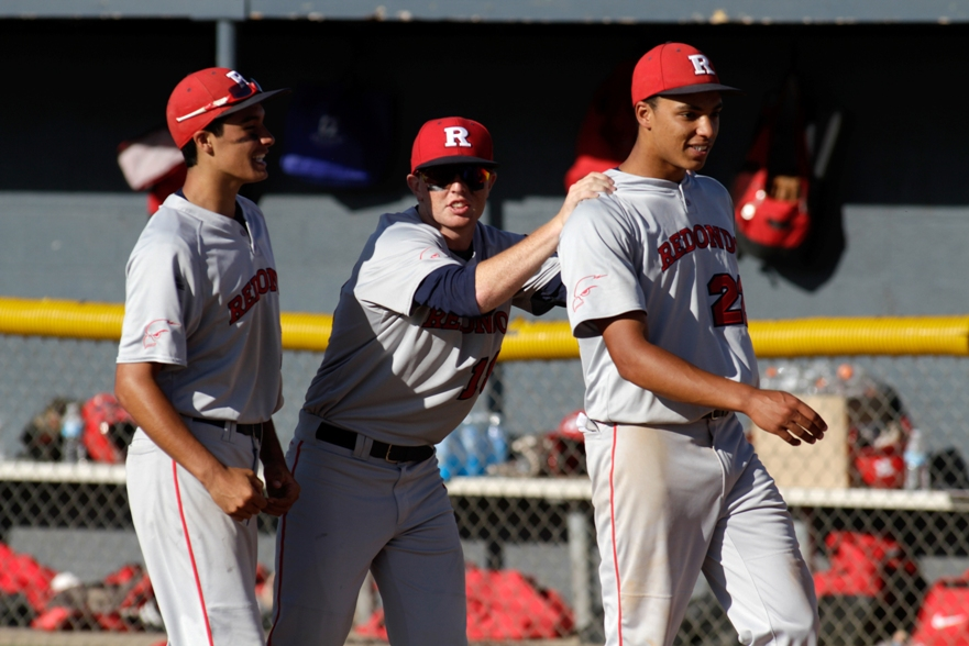 Jason Dicochea, Jason Clebowicz and Cassius Hamm celebrate Redondo's 3-2 quarterfinal win at Gahr. Photo by Ray Vidal