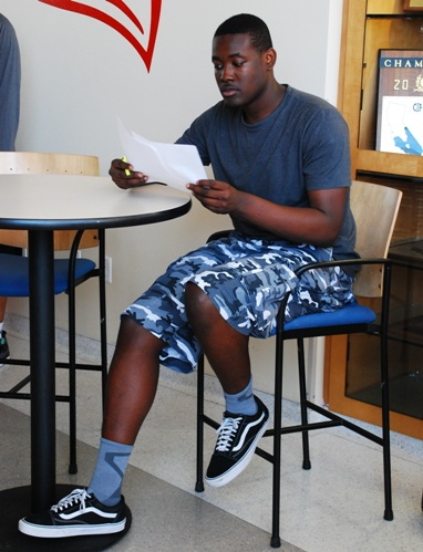 Terrell Carter double-checks the Letter of Intent he signed to play basketball at Fresno State. Photo by Randy Angel