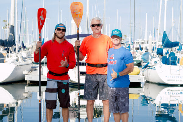 Rusty Dom with stand-up paddleboard coaches Brad Fyffe and Gene Smith of Tarsan Stand-up Paddleboards. Photo by Brad Jacobson (CivicCouch.com)
