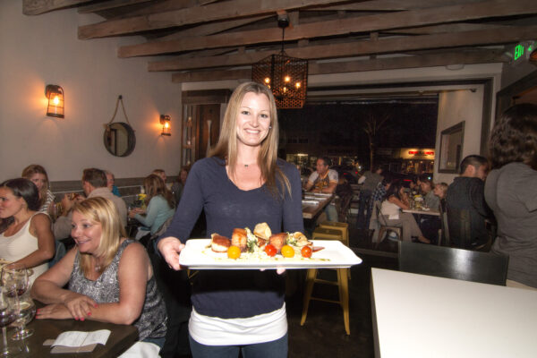 Hook & Plow's Lauren Cassity sarves the restaurant's scallop and pork belly BLT.