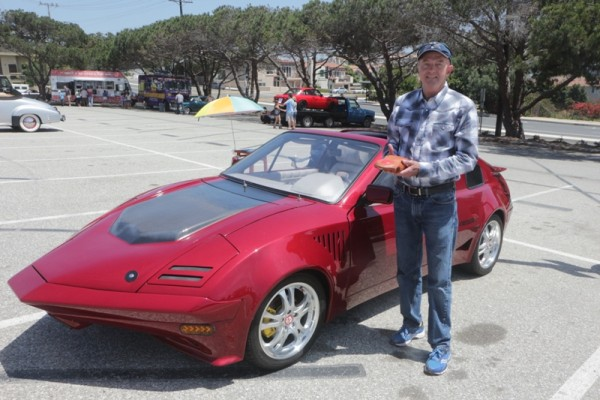Richard Franklin holds the clay model for his Freedom 1 alongside the car.