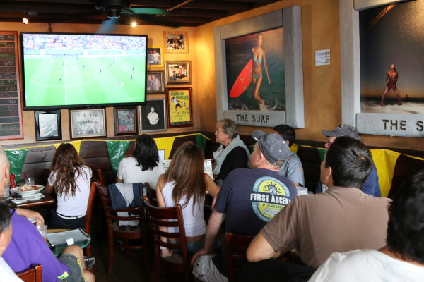 Soccer competes with surfing for the attention of customers in Silvio's Brazilian BBQ.
