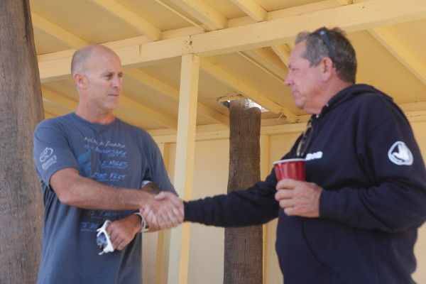 Race director George Loren  and  Disappearance skipper Ronnie Meistrell. Photo