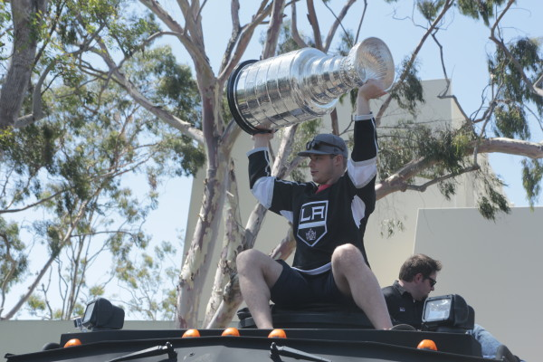 Kings captain Dustin Brown rallies fans at the start of the parade. Photo by Kevn Cody