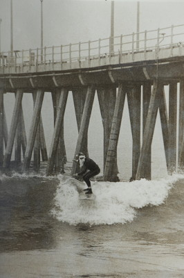 Paul Matthies surfing in a wool Santa Suit in 1978. Photo by Lind O'Donnell