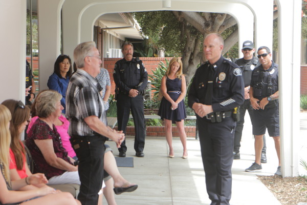Hermosa Beach Police Captain Tom Thompson welcomes Tom Moss and his family.