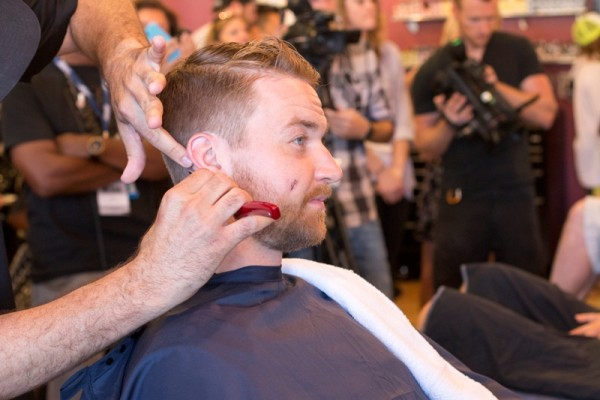 Kings Trevor Lewis puts is trust in the hands of Floyd's barber Jason Sandoval. Photo by Brad Jacobson