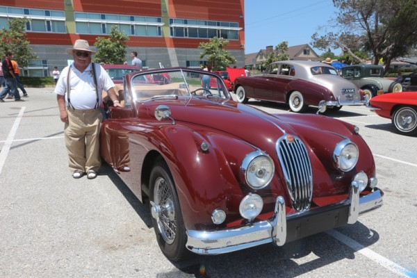 Phil Ludwig with is imperial maroon 1956 XK 140 DHC.